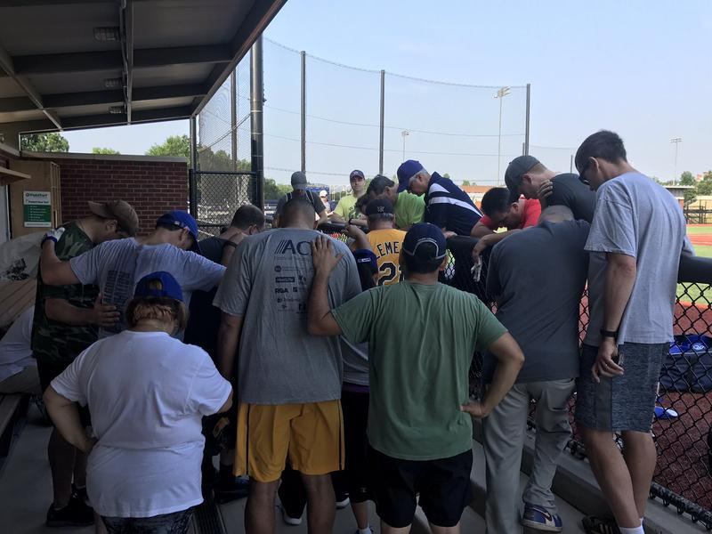 House Democrats pray at their own baseball practice in a picture tweeted out by Rep. Ruben J. Kihuen of Nevada after hearing of the shootings.