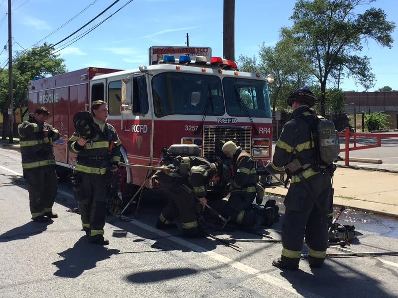A new shift of Kansas City firefighters prepare to spell other firefighters in Tuesday's scorching heat.