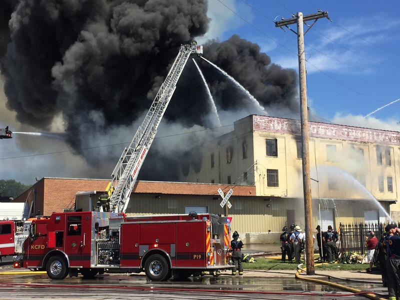 A three-alarm blaze broke out Tuesday afternoon on Southwest Boulevard at a furniture warehouse next to Shutte Lumber Company.