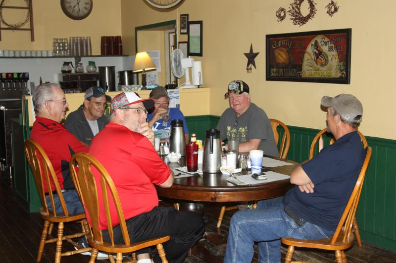 The regular 6 a.m. gathering at Fubbler's Cove diner in Orrick, Missouri, population 799.