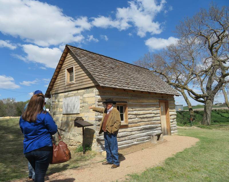 El Dean Holthus of Smith Center, Kansas, leads a tour of the property where Brewster Higley wrote 'Home on the Range,' including a restored cabin where Higley lived.