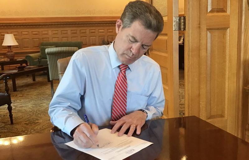 Gov. Sam Brownback vetoes a tax plan that would have rolled back many of his signature 2012 tax cuts.