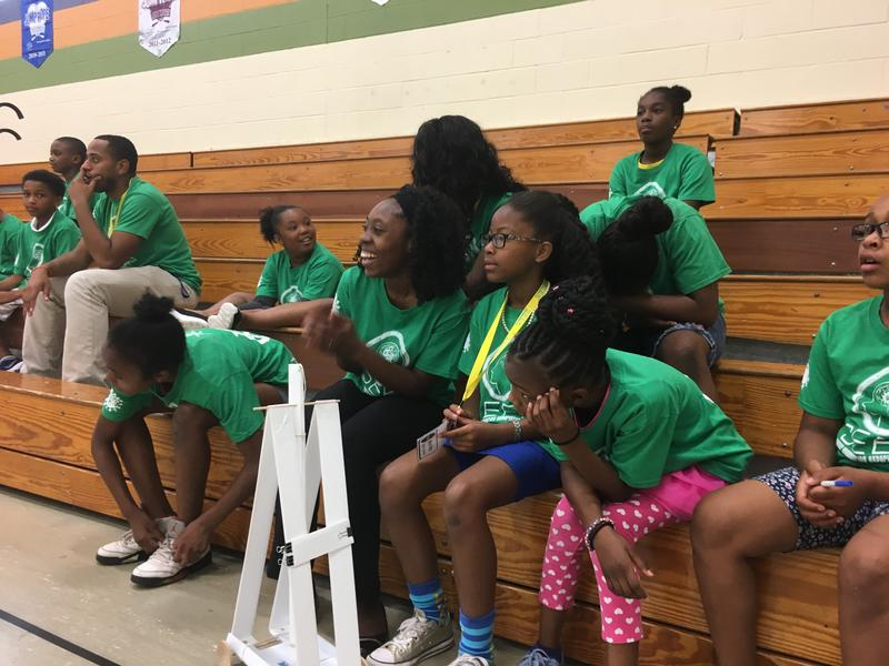 The girls participating in the Summer Engineering Experience for Kids (SEEK) camp cheer on their fellow campers.