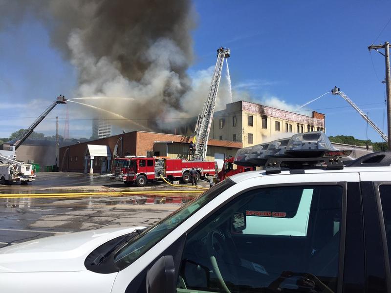 About 100 Kansas City firefighters battled a three alarm blaze Tuesday near Southwest Blvd. and I-35.