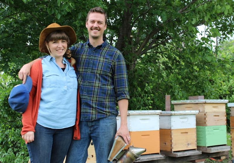 Rachael and Erik Messner, an artist and an engineer, stand next to their honey bee boxes in Raytown, Missouri.