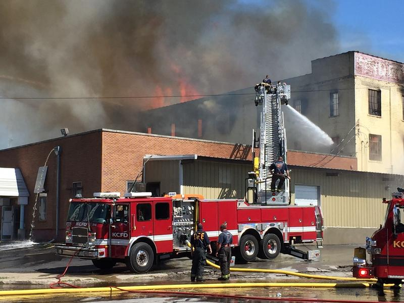 Fire burned through the roof at Fridays Furniture Outlet on Southwest Blvd. Tuesday.