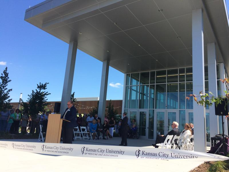 Joplin Mayor Mike Seibert leads the grand opening ceremony of the Kansas City University of Medicine and Biosciences campus in June with a prayer.