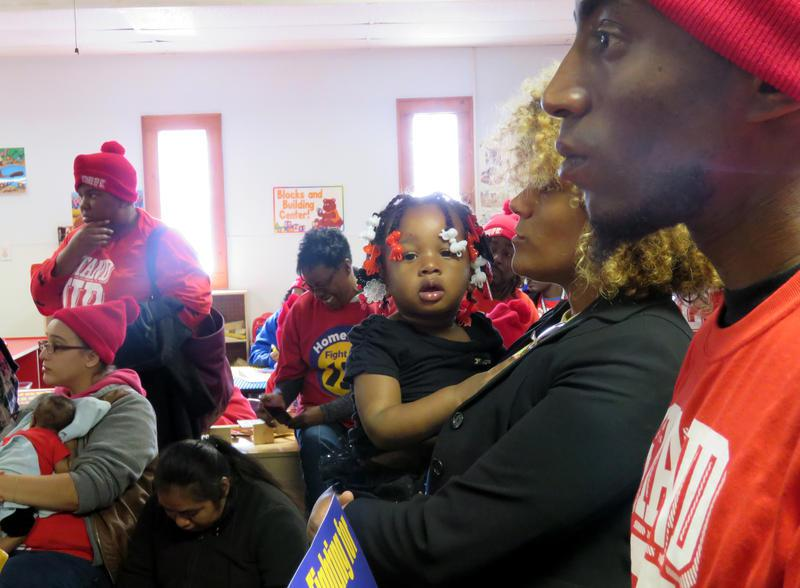 "Terrence Wise (right) stands in the crowd rallying for higher minimum wage in November 2015. Wise has been a leader in the ""Fight for 15"" movement in Kansas City."