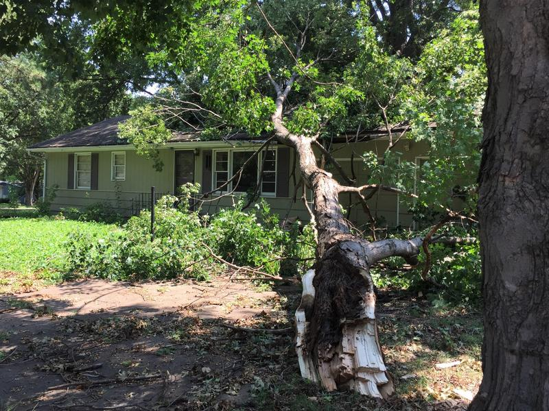 The Saturday night storm toppled a tree onto a house in Prairie Village, Kansas. A neighbor said it was about to be rented.