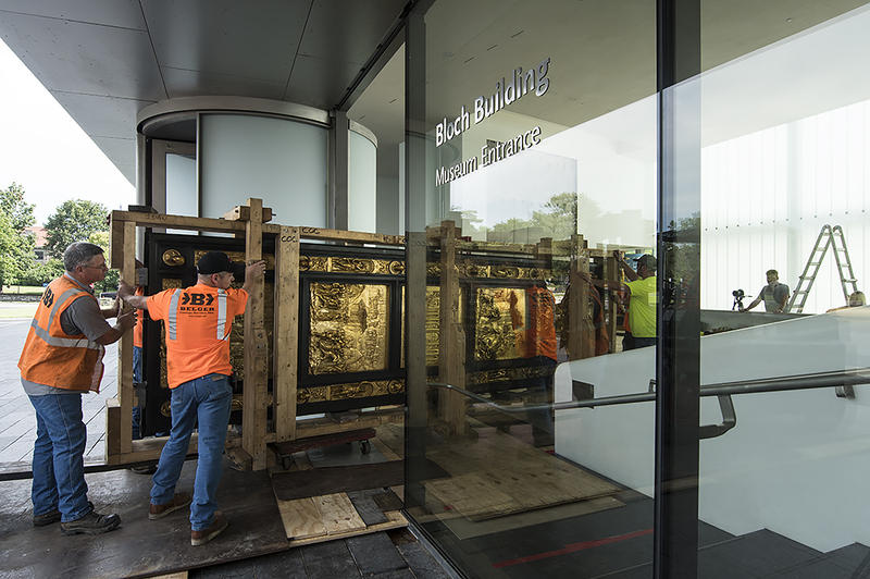 A crew from Belger Cartage Service, Inc., carefully moves one of two gilded bronze doors from a replica of Gates of Paradise, a masterpiece of the Italian Renaissance.