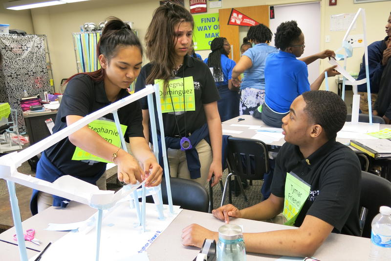 Tymar Friendly, right, works with classmates Legna Dominguez and Stephanie Nguyen on a science project. The three were eighth graders at KIPP Endeavor Academy last year.