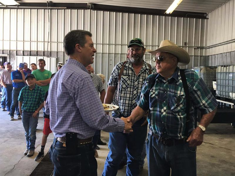 Gov. Sam Brownback meets farmers in Hoxie while touring western Kansas to tout his water conservation program.
