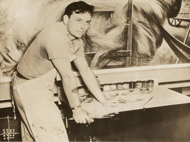"Joe Jones in a 1938 Associated Press photograph. The caption described him as a ""29-year-old St. Louisan, who quit painting houses to make a name for himself in oil and canvas.'"