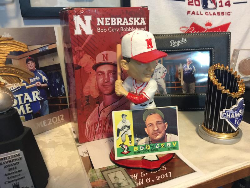 A Bob Cerv bobblehead, given away this year at a Huskers home game, and an autographed baseball card sit among Ray Van Eman's baseball memorabilia. Bob Cerv holds the Kansas City A's record for most home runs.