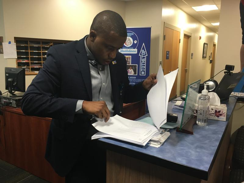 Many students who showed up at Banneker on Monday morning were not on the paper roster Principal Harrison Neal had printed out.