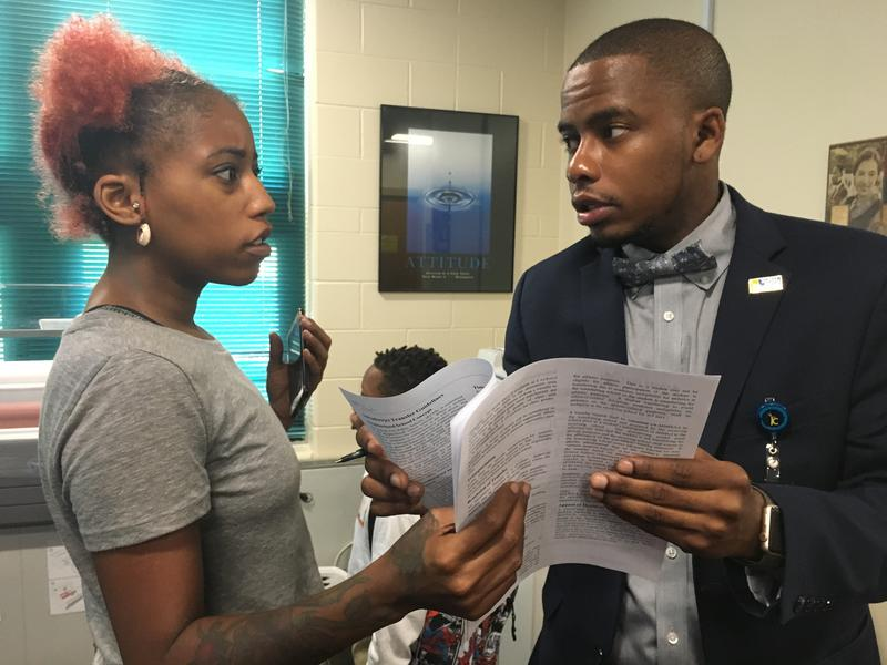 Principal Harrison Neal explains to a mother that unfortunately, she'll have to go to central office if she wants to transfer her son to Banneker.