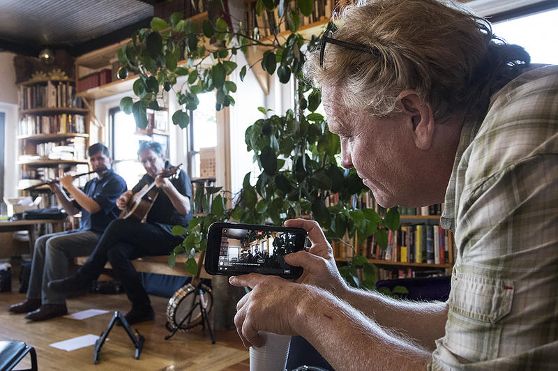 Will Leatham, co-owner of Prospero's Books, records a show.
