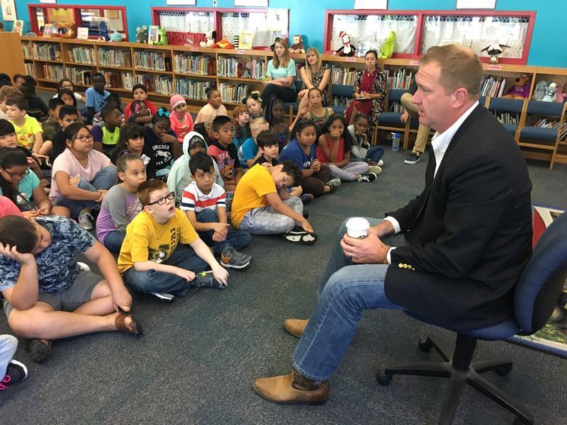 Missouri Treasurer Eric Schmitt talks to fourth graders in the North Kansas City School District about saving for college.