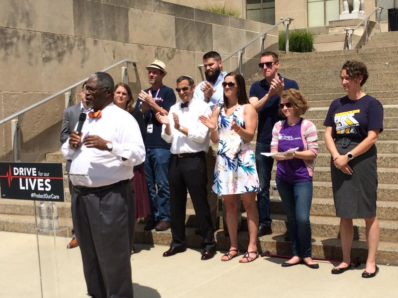 Kansas City Mayor Sly James spoke at a rally on the steps of City Hall Wednesday urging the preservation of the Affordable Care Act.