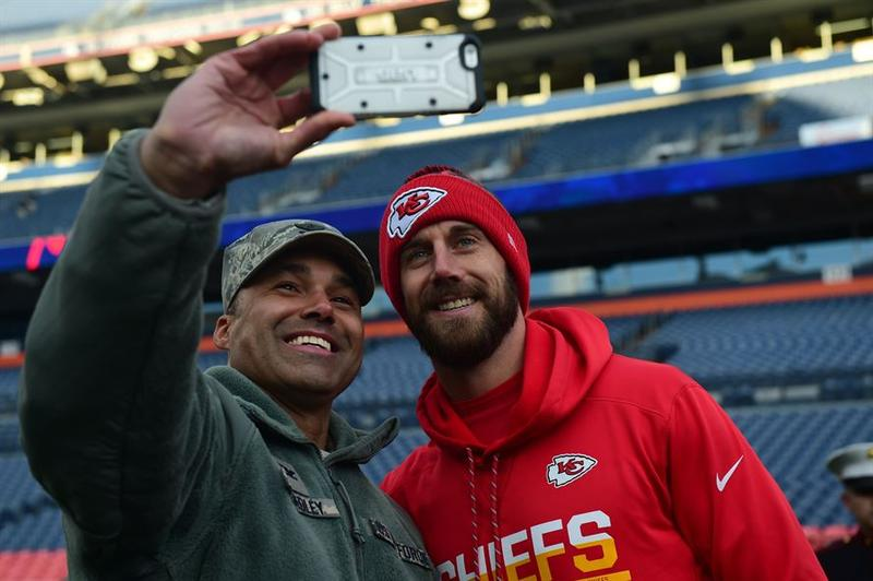 Alex Smith poses with Col. Lorenzo Bradley. An interview revealed that Smith listens to KCUR before games.