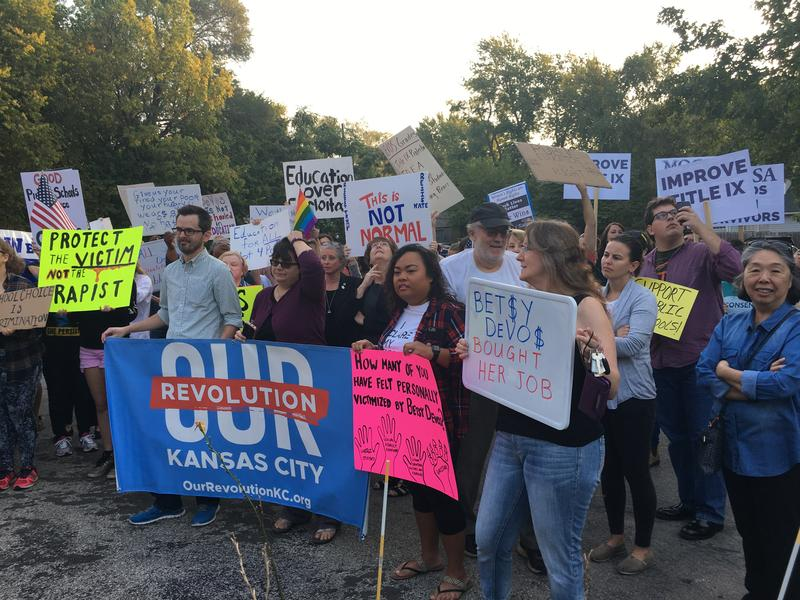 About 150 protestors gathered outside Kansas City Academy Friday morning to protest U.S. Secretary of Education Betsy DeVos' visit.