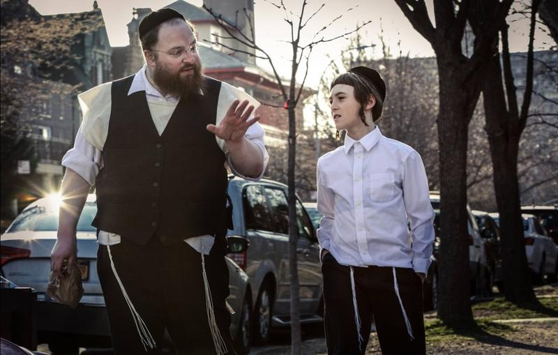 In 'Menashe,' the eponymous main character struggles to prove his faithfulness, make ends meet, and singlehandedly raise his son, all in accordance with the strict beliefs of his ultra-orthodox Hasidic Jewish community.