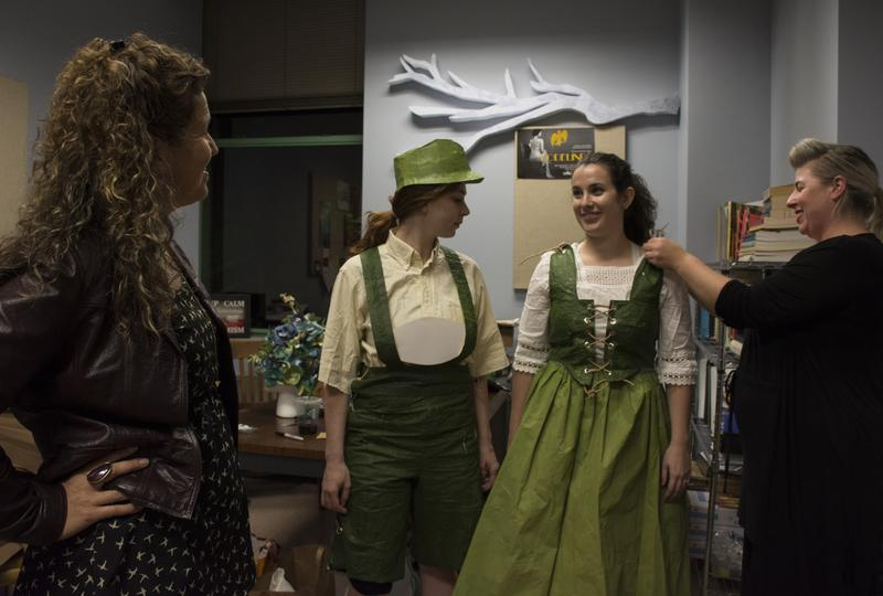 Paper is used for props and costumes in UMKC's 'Hansel and Gretel.' (left to right) Director Fenlon Lamb, Hansel (Katherine Menke), Gretel (Lydia Bechtel-Edmonson), and costume designer Maureen Thomas.