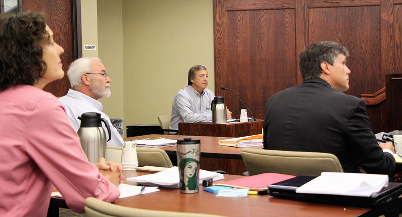 Cindy Hoedel, left, of Matfield Green recently discovered errors in some public notices for wastewater well permits. Also pictured at an August hearing are, from left, geologist Lee Shobe, Quail Oil manager Wray Valentine and attorney Robert Vincze.