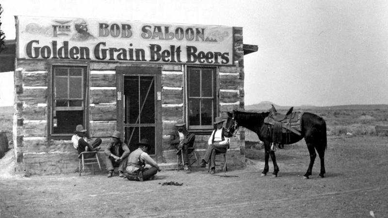 Cowboys take a load off at the Bob Saloon, Miles City, Montana, in 1880.