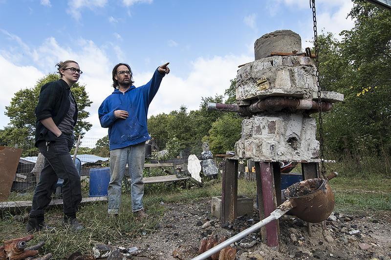 Michael Wickerson (right) shows a visiting artist one of two cupolas he's built behind his home in Wyandotte County. Wickerson will host about a dozen sculptors from around the United States and Canada next week for an iron pour workshop.