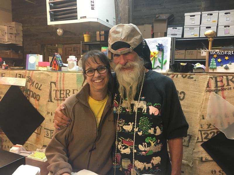 Scraps KC Executive Director Brenda Mott with Cracker, a homeless volunteer.