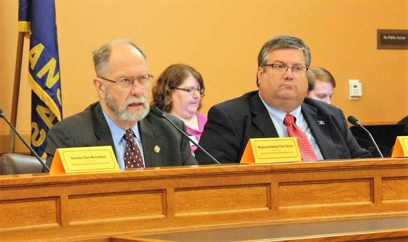 Rep. Tom Sloan, left, and Rep. Ken Rahjes discussed policy priorities with other members of the Legislature's Special Committee on Natural Resources during a Monday meeting in Topeka.