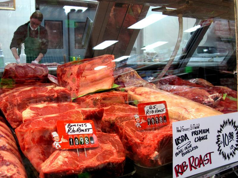 Three meat companies process most of the beef that lands in U.S. supermarkets. Some farmers say that gives the companies too much power over the price of cattle.