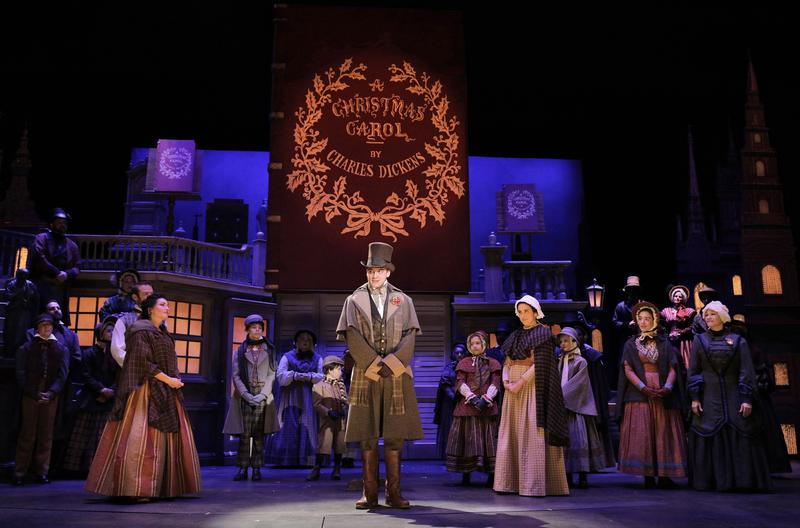 Charles Dickens' book, 'A Christmas Carol,' pops up in the set design of the Kansas City Rep's production.
