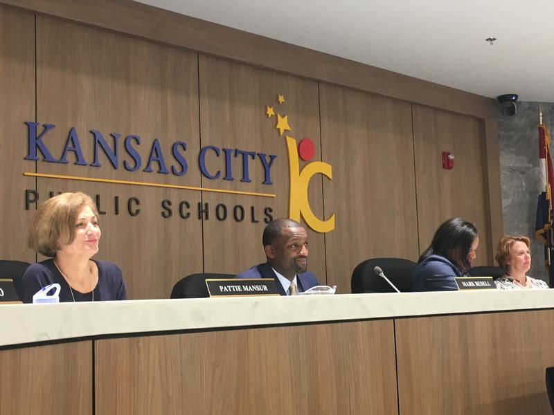 KCPS Superintendent Mark Bedell, center, listens to a presentation at an October meeting of the Board of Directors.