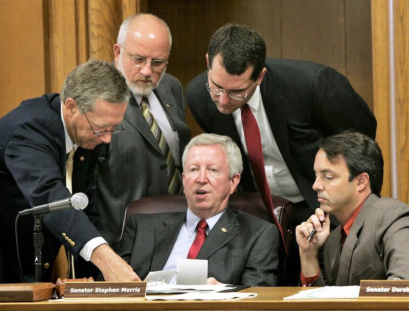 Senate President Steve Morris, center, talks with fellow senators during a school finance vote in June 2005. From left are John Vratil, R-Leawood; Dwayne Umbarger, R-Thayer; Derek Schmidt, R-Independence; and Chris Steineger, D-Kansas City.
