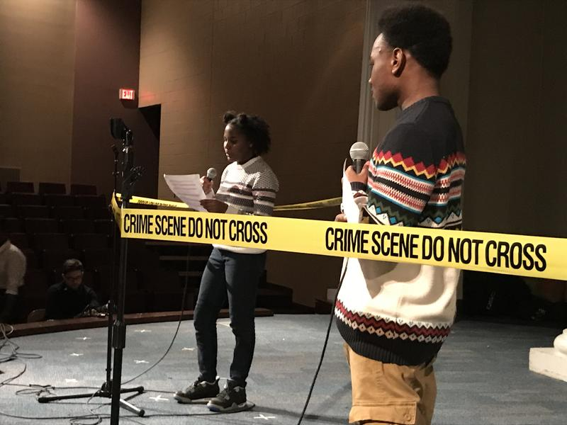 Khia Washington and Damon King performing their drama 'The Argument' for a crowd of students and community members at Central Academy of Excellence.