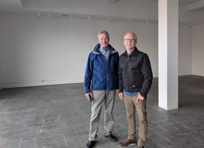 Bill Lyons (left) and Bill Haw Jr. in the former Kemper at the Crossroads space to be occupied by an expanded Haw Contemporary.
