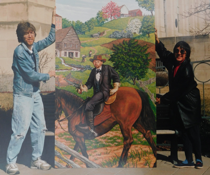 A 1993 photograph shows artist David McClain and Clay County Mural Committee Chair Angie Borgedalen holding a mural panel depicting the outlaw Jesse James.