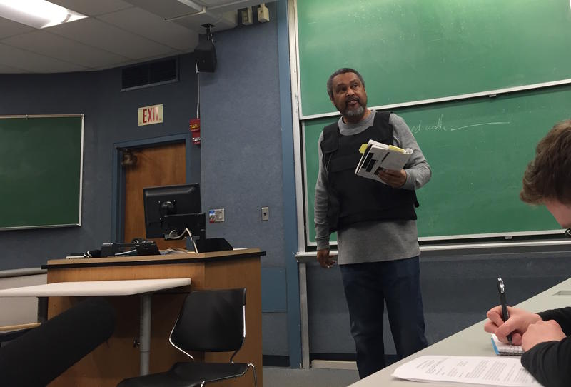 University of Kansas film professor Kevin Willmott wears his bullet-proof vest on the first day of the spring semester.