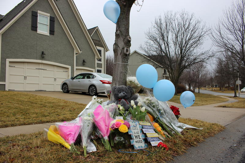 Balloons and flowers outside of the home of an Overland Park teen who was shot and killed by police in January.
