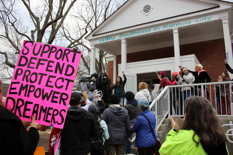 Jacquie Lenati-Fernandez welcomes the crowd after their 3-mile 'women's march' from Brookside to Unity Southeast church.
