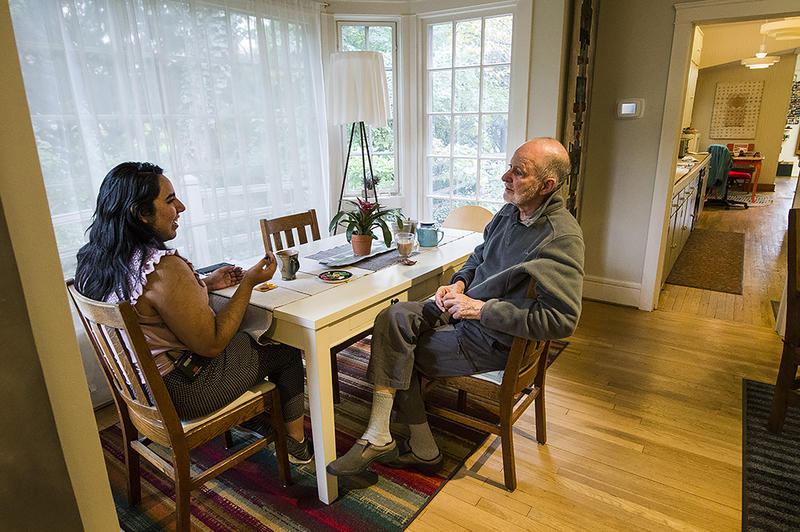 Diana Lerma, a senior in the fiber department at the Kansas City Art Institute, chats over a cup of tea with retired professor Jason Pollen. Pollen's teatime visits have helped shape several generations of art students.