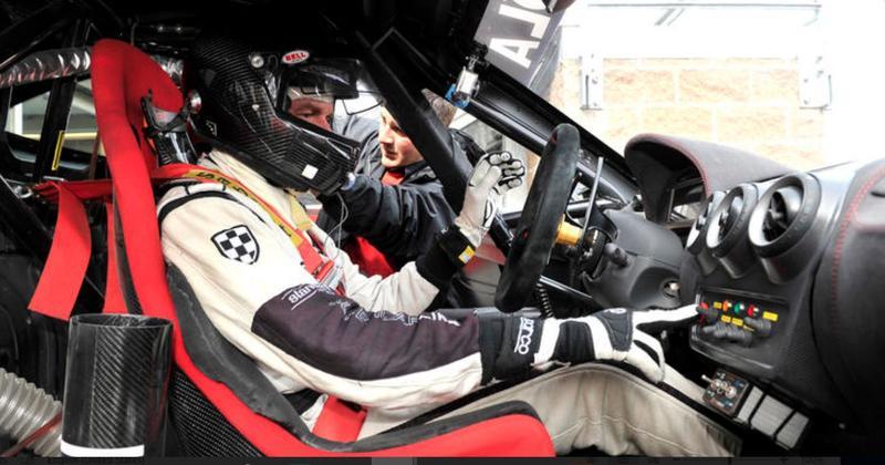 Scott Tucker in a Ferrari F430 he drove for his racing car company, Level 5 Motorsports.