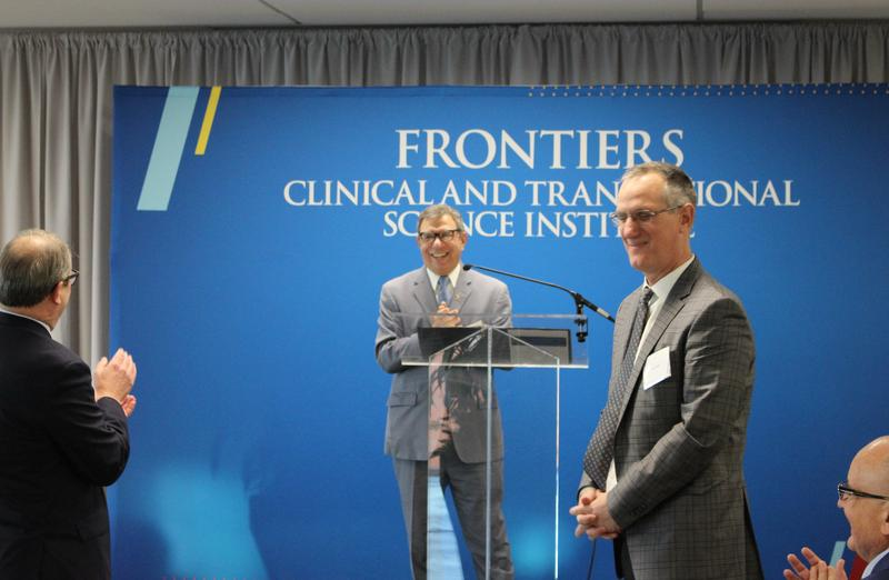 Frontiers director Rick Barohn announces a $25 million grant from the National Institutes of Health Monday.