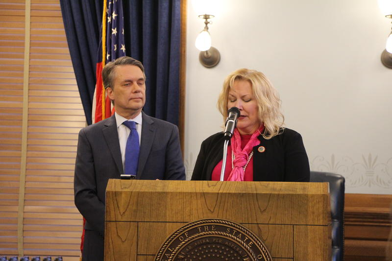 Lieutenant Governor Jeff Colyer stands beside Kansas Department for Children and Families Secretary Gina Meier-Hummel as she announces plans to address some of the the high-profile problems with Kansas's foster care system.
