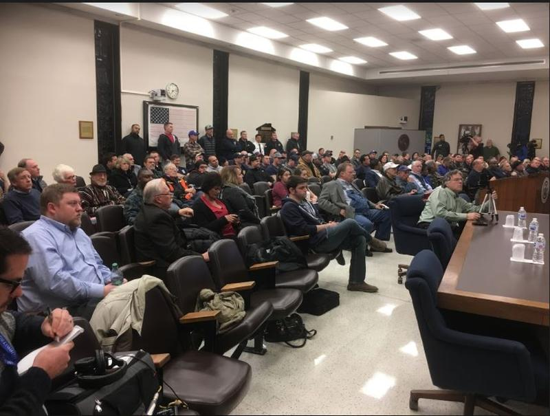 Supporters and opponents of Mayor Mark Holland packed a special meeting he called to discuss the findings of a report on the fire department.