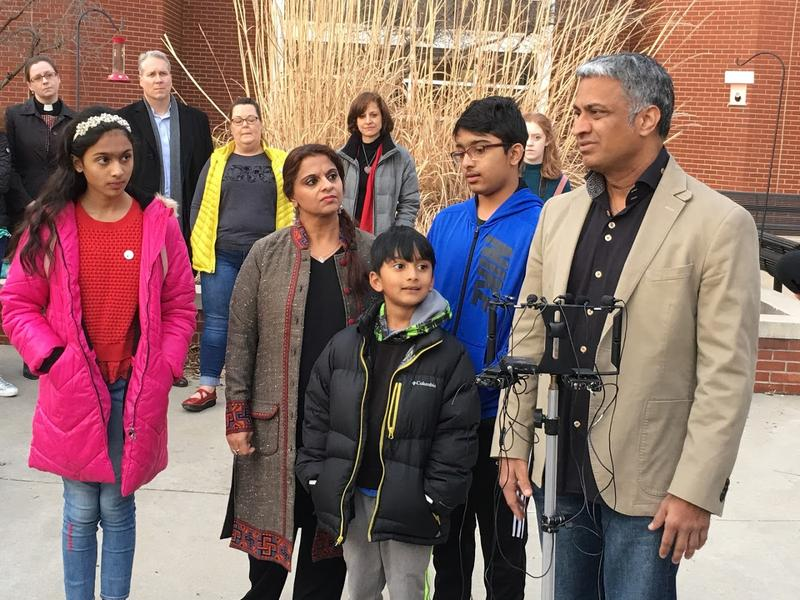 Syed Jamal's brother speaks at a news conference Wednesday while Jamal's children and Rekha Sharma-Crawford, Jamal's attorney, look on.