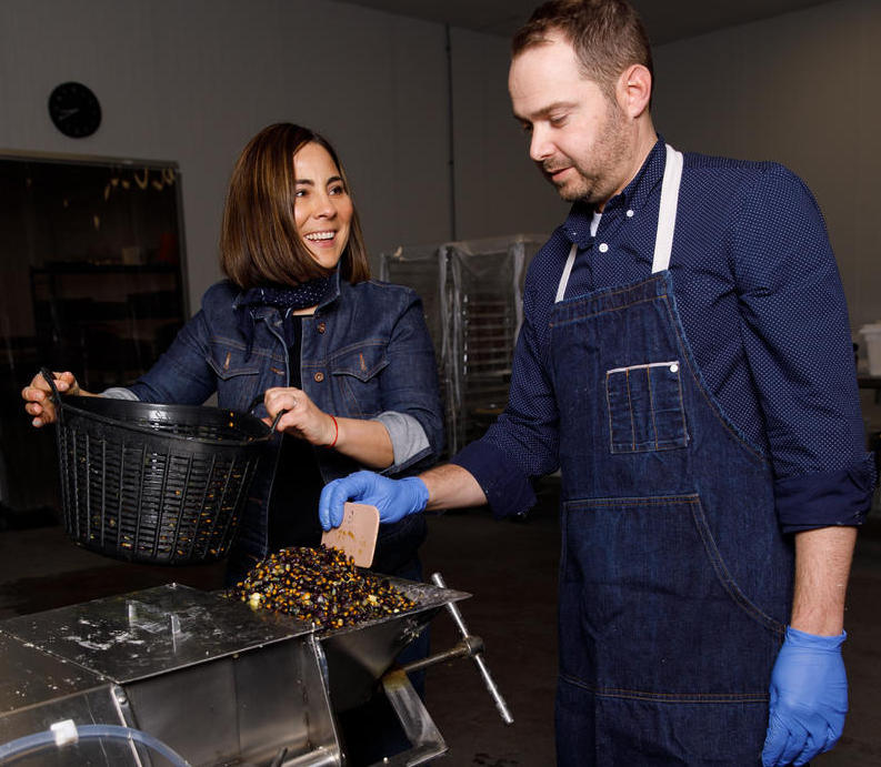 Marissa and Mark Gencarelli, owners of Yoli Tortilleri, grind yellow, blue and red corn to make taco-sized tortillas.