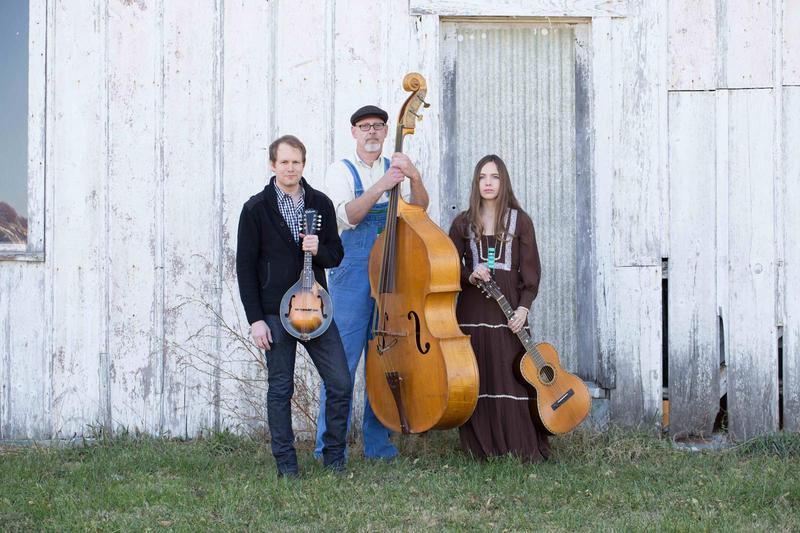 Simon Fink, left, with his Under the Big Oak Tree band mates Doug Ward and Kristin Hamilton.